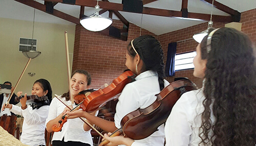 Education-3---young-ladies-playing-violin-web